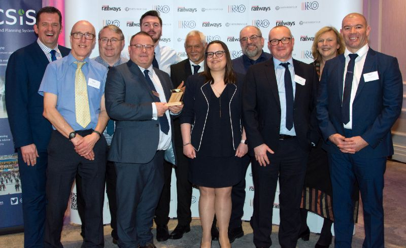 Merseyrail staff accepting Golden Whistle Award